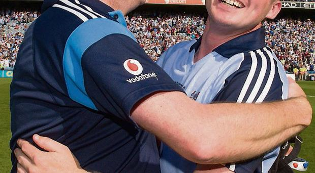 Dotsy O'Callaghan embraces Anthony Daly