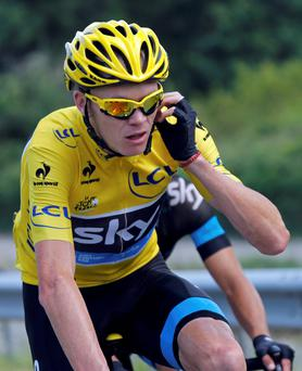 Race leader's yellow jersey holder Team Sky rider Christopher Froome