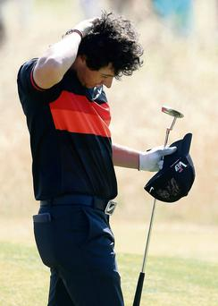 A dejected Rory during his second round –'the golfer is in competition with himself or herself and with each and everyone before and after'.