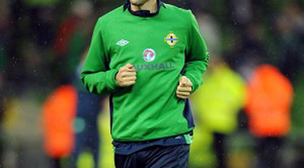 Gareth McAuley. pictured, has expressed concerns over David Martin's re-appointment