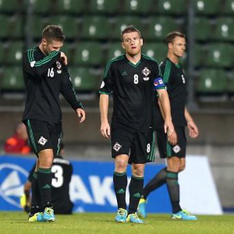 Oliver Norwood, left, and captain Steven Davis stand dejected after conceding