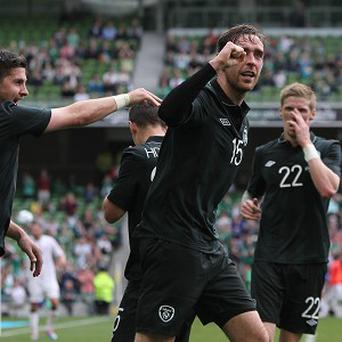 Richard Keogh celebrates his goal against Georgia