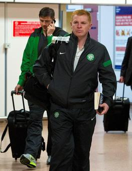 Celtic manager Neil Lennon walks through Glasgow Airport, Glasgow after Celtic arrived back home after their unlucky defeat to AC Milan in the UEFA champions League