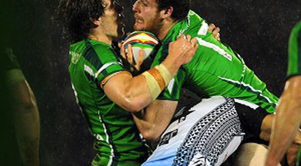 Ireland's World Cup hopes hang by a thread after a 32-14 defeat to Fiji at Spotland.