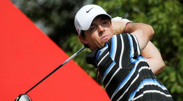 Early leader Rory Mcllory of Northern Ireland tees off at the 9th hole during the second round of the HSBC Champions golf tournament at the Sheshan International Golf Club in Shanghai