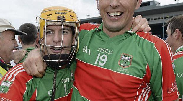 Loughmore-Castleiney's Evan Sweeney (left) with Michaeal Webster