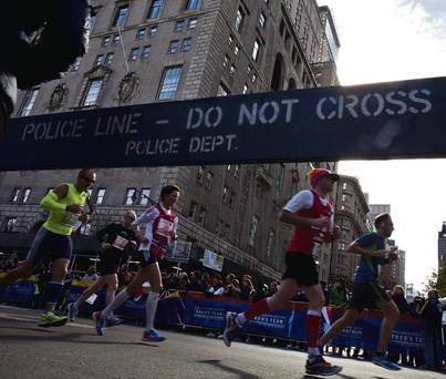 Runners make their way through the borough of Manhattan during the New York City Marathon in New York on November 3, 2013