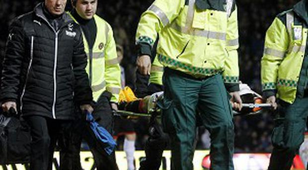 Andy Little left the field on a stretcher
