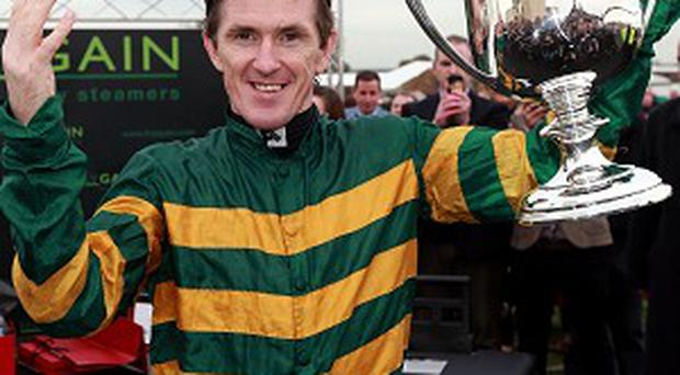 Tony McCoy celebrates his 4,000th winner at Towcester
