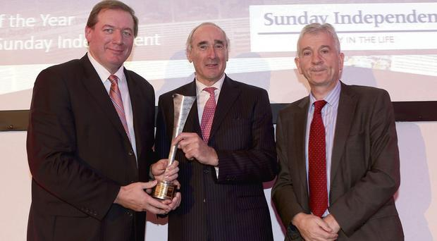 Neil Francis recieves his Sports Columnist of the Year award from Matt Dempsey, chairman of the NNI, and PJ Cunningham, a member of the judging panel; and, below, nominees Marie Crowe and Dion Fanning at the awards ceremony.