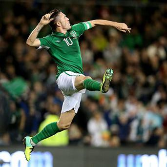 Robbie Keane celebrates scoring Ireland's first goal
