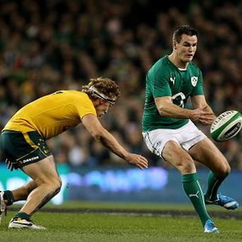 Ireland's Jonathan Sexton (right) and Australia's Michael Hooper, who scored two tries in the visitors' win.