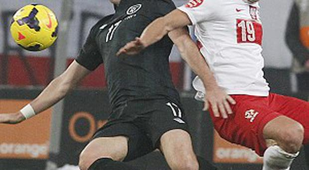 Poland's Piotr Celeban, right, and Ireland's Stephen Ward, left, challenge for the ball (AP)