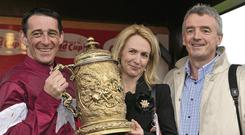 Michael O'Leary (right) with Davy Russell (left) and his wife Anita (centre). Barry Cregg / SPORTSFILE