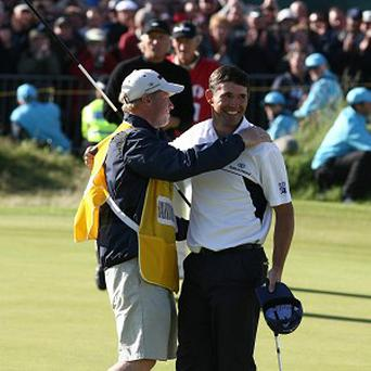 Padraig Harrington needed a stand-in caddie when Ronan Flood was taken ill during the second round of the Volvo Golf Champions in Durban on Friday.