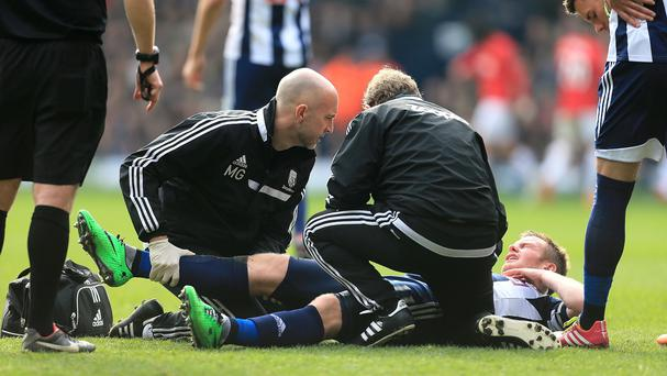 Chris Brunt receives treatment during West Brom's match against Manchester United on Saturday