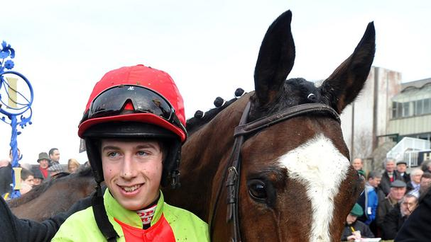 Bryan Cooper broke his leg while racing in the Fred Winter Juvenile Handicap Hurdle