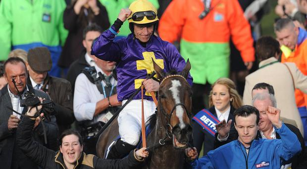 Davy Russell celebrates on Lord Windermere after winning the Gold Cup at Cheltenham