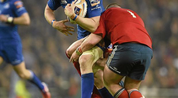 Leinster's Jamie Heaslip is tackled by Dave Foley and Dave Kilcoyne at Aviva Stadium last night. Photo: Brendan Moran