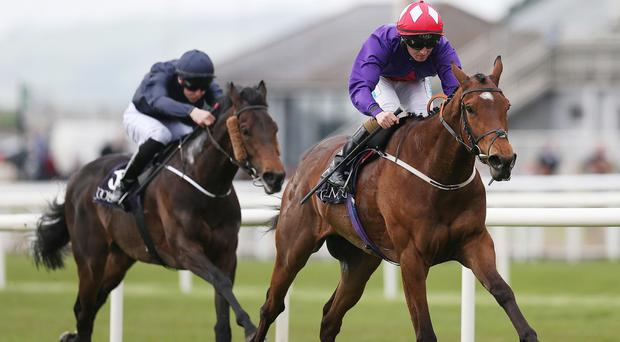 Sruthan ridden by Chris Hayes, right, goes on to win the Power European Breeders Fund