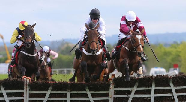 Beat That, black cap, ridden by Barry Geraghty wins The Irish Daily Mirror Novice Hurdle