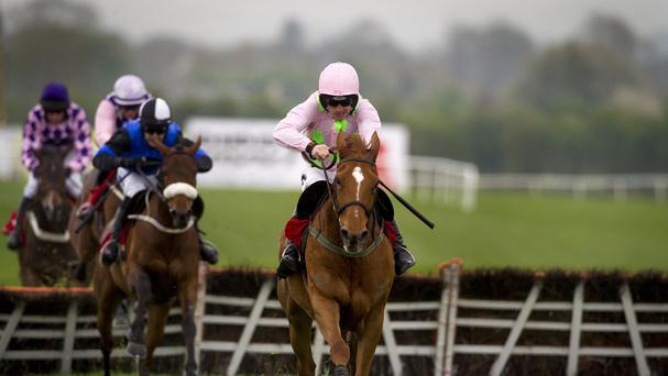 Annie Power, right, eased home in the Irish Stallion Farms EBF Mares Champion Hurdle by seven lengths