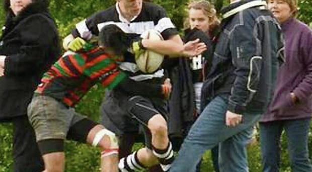 Winger Harry Bayford was bearing down on the line in the Hertfordshire Shield cup final in England when the father stuck out a leg to stop him scoring his third try of the game