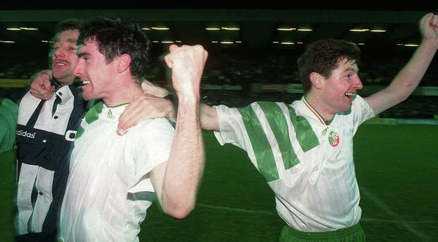 Alan McLoughlin (centre) celebrates Ireland's qualification to the 1994 World Cup with team-mates Denis Irwin and John Aldridge (left) after he scored the crucial equaliser against Northern Ireland in Windsor Park in 1993