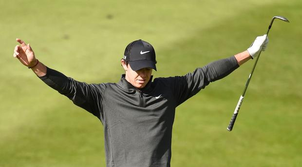 Rory McIlroy celebrates chipping in for an eagle at Wentworth
