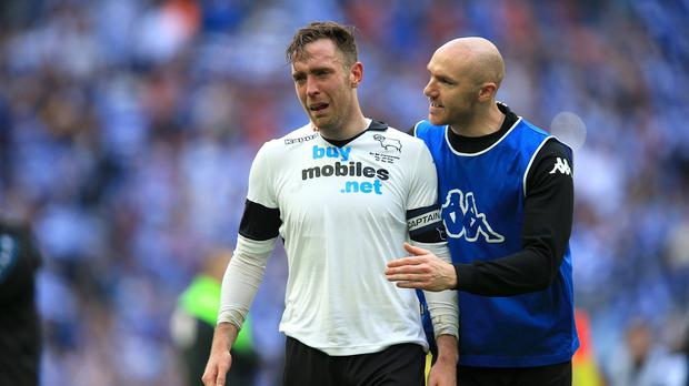 Derby's Irish defender Richard Keogh, left, with fellow Irishman Conor Sammon after suffering a Championship play-off final defeat to QPR back in 2014. Keogh will seek redemption in Monday's final against Aston Villa
