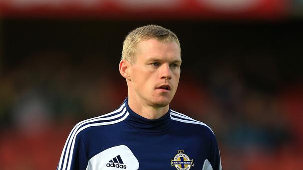 Northern Ireland striker Billy McKay is pleased to be getting his chance in South America
