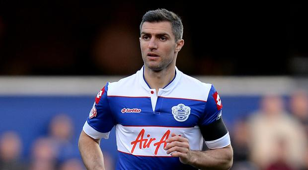 Aaron Hughes is waiting to see if he has a future at QPR