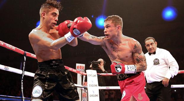Carl Frampton, pictured right, believes home support will overwhelm Kiko Martinez