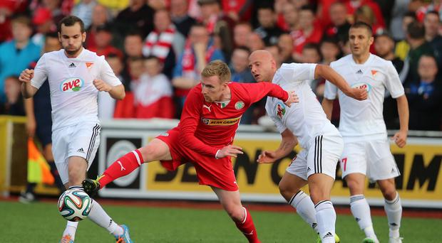 Chris Curran, centre, went close for Cliftonville