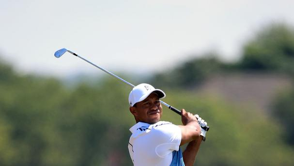 Tiger Woods took advantage of good scoring conditions to shoot a three-under 69 on the first day of the 143rd Open Championship at Royal Liverpool
