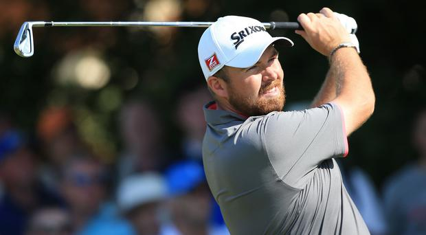 Shane Lowry claimed a share of third place on Thursday