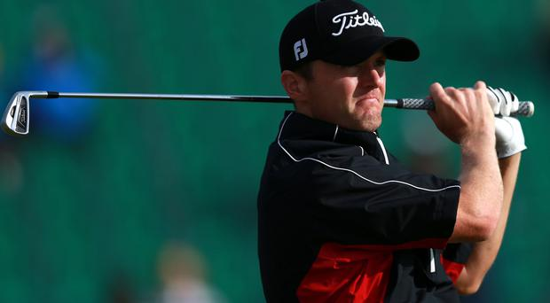 Michael Hoey pulled out of the Open Championship with an injured foot