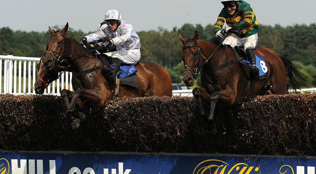 It's A Gimme (right), ridden by AP McCoy jumps the last fence to win the Betfred Summer Plate at Market Rasen