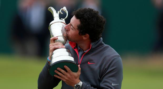 Rory McIlroy celebrates with the Claret Jug