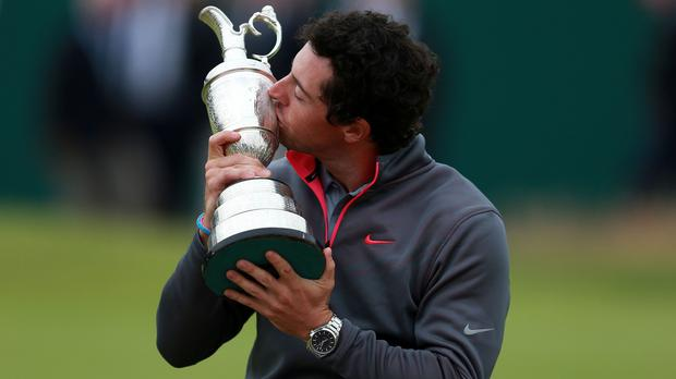 Rory McIlroyhas admitted to taking picture of the Claret Jug on the toilet