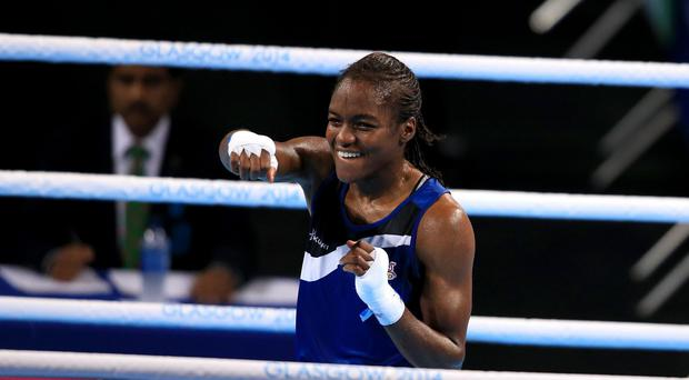 Nicola Adams, pictured, celebrates her gold medal win over Michaela Walsh