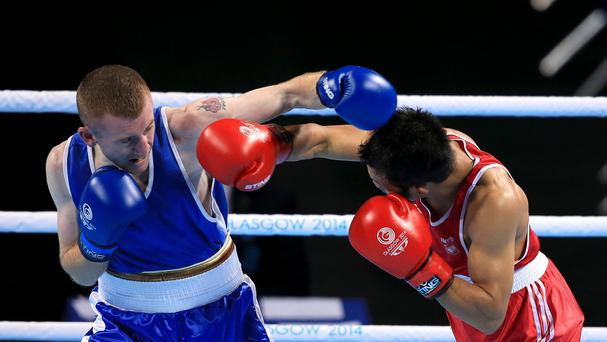 Paddy Barnes, left, retained his title by beating Devendro Laishram, right