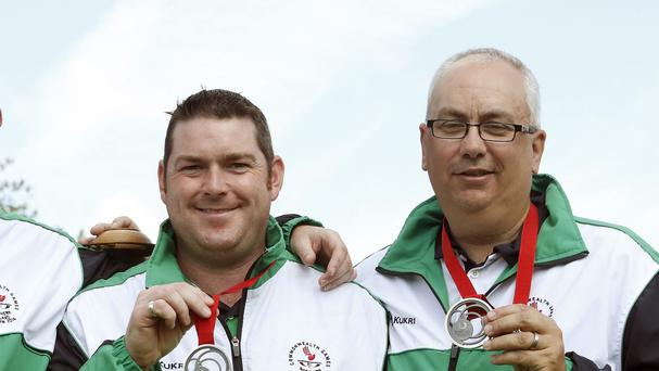 Neil Booth, right, will carry Northern Ireland's flag at the closing ceremony