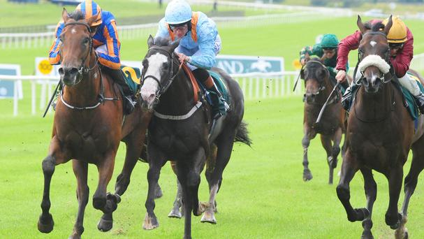 Dick Whittington, left, just gets the better of Kool Kompany