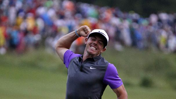 Rory McIlroy shows his elation after winning a third successive tournament (AP)