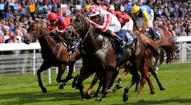 Richard Hughes nudges Sole Power into a late lead