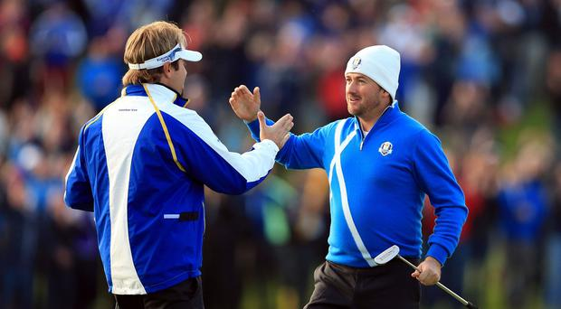 Graeme McDowell, right, believes Ryder Cup partner Victor Dubuisson will become Europe's next superstar.