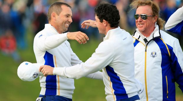 Rory McIlroy, centre, claimed his first win of the week alongside Sergio Garcia, left, on Saturday