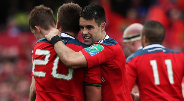 Conor Murray, centre, was one of the try-scorers for Munster