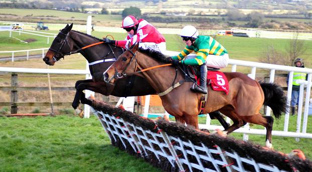 Total Recall (far side) clears the last with Oscar Knight on his way to winning at Punchestown